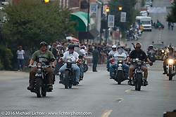 Kelly Modlin parades up Spanish Street with a police escort after the hosted dinner stop in Cape Girardeau, Missouri during Stage 5 of the Motorcycle Cannonball Cross-Country Endurance Run, which on this day ran from Clarksville, TN to Cape Girardeau, MO., USA. Tuesday, September 9, 2014.  Photography ©2014 Michael Lichter.
