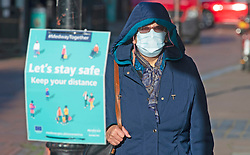© Licensed to London News Pictures. 01/12/2020. <br /> Rochester, UK. A shopper wearing a mask in Rochester High Street in Medway, Kent today. Kent has two of the worst effected Coronavirus areas in England with Medway behind Swale despite a fall in infections. Kent will be placed in tier 3 tomorrow when the lockdown ends. Photo credit:Grant Falvey/LNP