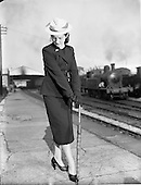 1952 - Miss Trudy Doyle, fashion special at a train station