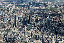 © Licensed to London News Pictures. 26/04/2016. London, UK. Aerial view looking towards the City of London and Canary Wharf, Isle of Dogs. Buildings including 30 St Mary Axe The Gerkin, Sky Garden 30 Fenchurch Street.  Photo credit: Martin Apps/LNP