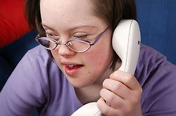 Teenage Downs Syndrome girl on the telephone,