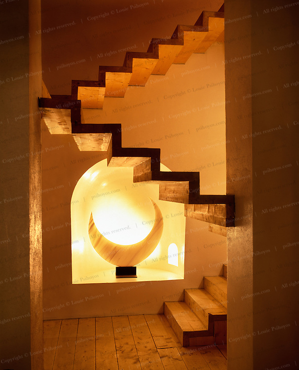 A magical stairway leads to the lower galleries in his home.
