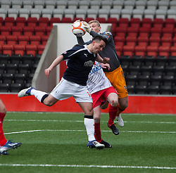 Falkirk's Sean Higgins and Airdrie United's keeper Robbie Thomson..Airdrie United 0 v 1 Falkirk, 30/3/2013..©Michael Schofield..