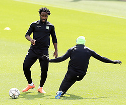 Eliaquim Mangala of Manchester City slide tackles Wilfried Bony during training - Mandatory byline: Matt McNulty/JMP - 25/04/2016 - FOOTBALL - City Football Academy - Manchester, England - Manchester City v Real Madrid - UEFA Champions League Training Session