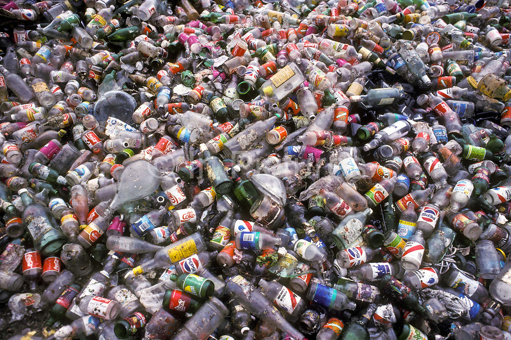 Plastic and glass bottles and other detritus on a rubbish dump in Mexico city, Mexico