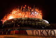 Fireworks during the opening ceremony at the new National Stadium, Gaiemmae, Tokyo, Japan. Friday July 23rd 2021. The delayed 2020 Tokyo Olympics opened on Friday July 23rd despite increasing Coronavirus infection numbers meaning there were no spectators inside the stadium to watch the opening ceremony.
