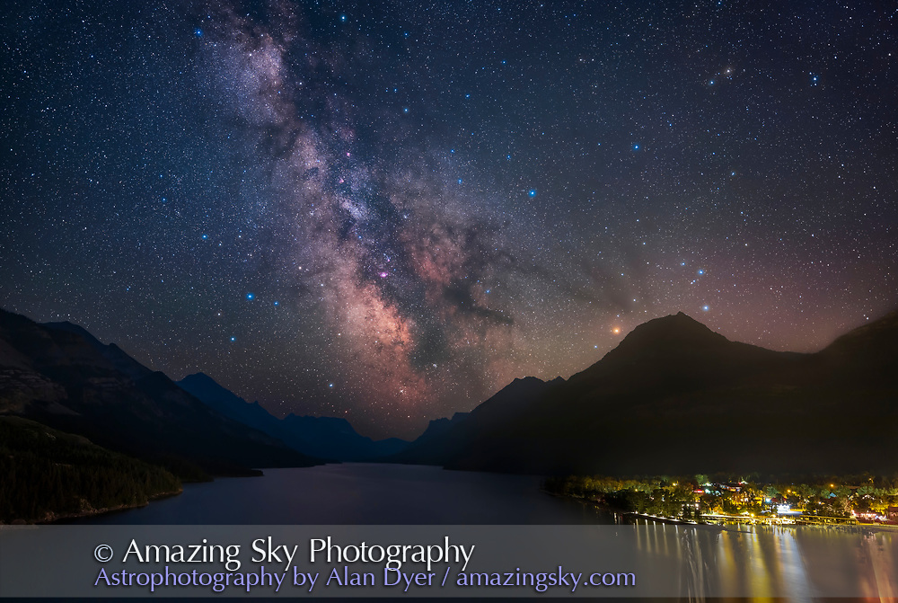 The summer Milky Way and galactic core region over Upper Waterton Lake and Waterton Townsite on a July evening. <br /> <br /> This was from the famous viewpoint of the Prince of Wales Hotel, looking south with Sagittarius and the Galactic Centre positioned over the lake. Scorpius is at right with reddish Antares. The M6 and M7 star clusters are low over the lake. The pinkish Lagoon Nebula, M8, is left of centre, with the M24 Small Sagittarius Starcloud above. Some forest fire smoke dampened the contrast and transparency this night.<br /> <br /> This is a blend of tracked exposures for the sky and untracked exposures for the ground: a stack of 4 x 2-minute tracked at ISO 1600 and f/2.8 for the sky and a stack of 3 x 4-minute untracked at ISO 800 and f/4 for the ground. LENR noise reduction applied in-camera to the ground images to reduce thermal speckling on this warm night. <br /> <br /> An additional short 30-second exposure at ISO 400 and f/5.6 masked in is for the town lights to subdue their brightness, though the result does better resemble the naked eye view, as the lighting has been reduced and shielded recently to make it much less glaring than before. An additional 2-minute tracked exposure at the end of the sequence taken through a Kase/Alyn Wallace Starglow filter blended in add the star glows! <br /> <br /> The tracker was the Star Adventurer Mini which worked perfectly and consistently. The camera was the Canon EOS Ra with the 15-35mm RF lens at 24mm.