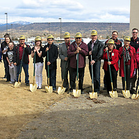 Michael Sullivan/Independent                  Grants-Cibloa School Board members, administrators and students get into the act during a groundbreaking ceremony Wednesday for expansion of the Grants High School Performing Arts Center. The entrance will face Mt. Taylor, seen in the background.