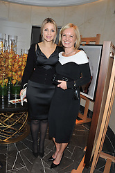 Left to right, EUGENIA TYMOSHENKO daugter of the imprisoned former Ukrainian Prime Minister Yulia Tymoshenko and MARIELLA FROSTRUP at The Great Initiative event in association with jewellers Boodles held at The Corinthia Hotel, London on 6th November 2012.