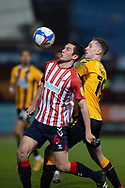 Oldham Athletic midfielder Ben Garrity (6) battles for possession with Adam May (19) of Cambridge United during the EFL Sky Bet League 2 match between Cambridge United and Oldham Athletic at the Cambs Glass Stadium, Cambridge, England on 5 December 2020.