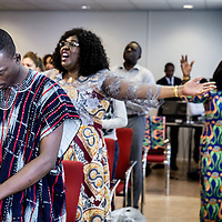 Nederland, Amsterdam, 10 juli 2016.<br /> Zondagochtend kerkdienst in Winners Chapel Zuid Oost.<br /> Living Faith Church Worldwide (ook bekend als Winners Chapel) is een mega-kerk en een christelijk kerkgenootschap opgericht door bisschop David Oyedepo in 1981. (Bron: Wikipedia)<br /> <br /> Netherlands, Amsterdam, July 10, 2016.<br /> Sunday morning church service at Winners Chapel in Zuid Oost. <br /> Living Faith Church Worldwide (also known as Winners Chapel) is a megachurch and a Christian denomination founded by Bishop David Oyedepo in 1981. (Source: Wikpedia)<br /> <br /> Foto: Jean-Pierre Jans