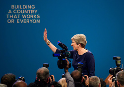 """© Licensed to London News Pictures. 04/10/2017. Manchester, UK. The letters F and E fallen off the conservative party slogan  """"BUILDING A COUNTRY THAT WORKS FOR EVERYONE"""" at the and of the speech.  British prime minister THERESA MAY delivers her leaders speech on the final day of the Conservative Party Conference. The four day event is expected to focus heavily on Brexit, with the British prime minister hoping to dampen rumours of a leadership challenge. Photo credit: Ben Cawthra/LNP"""
