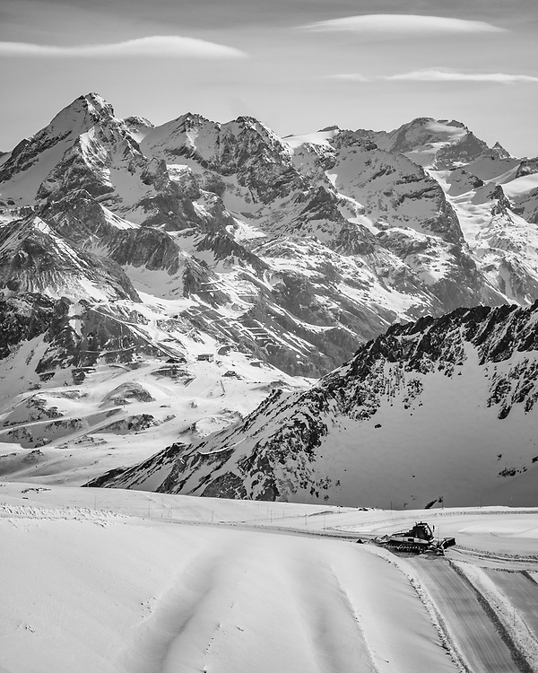 Preparing the slopes. Looking out to the slopes below the Grande Motte in Tignes and the Espace Killy ski area - a wonderful 300km+ of trails and plenty of off-piste fun for all.