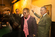 SIR ELTON JOHN; DAVID FURNISH, The English Gentleman at the  The Cabinet War Rooms, supported by Chivas deluxe blended Scotch whisky. Whitehall. London. 7 January 2013.