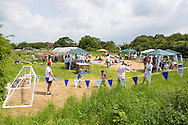 20140601 Free for editorial use image<br /> <br /> Halifax colleagues in Bournemouth are proud to give extra back to their local community by hosting their Big Lunch event on Sunday 01 June 2014.<br /> <br /> A general view of The Big Lunch at the New Leaf Allotment in Bournemouth. <br /> <br /> For more information please contact: Catherine Eastham on 020 3697 4304<br /> <br /> If you require a higher resolution image or you have any other onEdition photographic enquiries, please contact onEdition on 0845 900 2 900 or email info@onEdition.com<br /> This image is copyright the onEdition 2014©.<br /> This image has been supplied by onEdition and must be credited onEdition. The author is asserting his full Moral rights in relation to the publication of this image. Rights for onward transmission of any image or file is not granted or implied. Changing or deleting Copyright information is illegal as specified in the Copyright, Design and Patents Act 1988. If you are in any way unsure of your right to publish this image please contact onEdition on 0845 900 2 900 or email info@onEdition.com