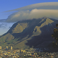 Lenticular cloud over Table Mountain, above modern Cape Town.