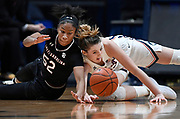 South Carolina's Tyasha Harris, left, and Connecticut's Katie Lou Samuelson dive for a loose ball during the second half of an NCAA college basketball game, Monday, Feb. 11, 2019, in Hartford, Conn. (AP Photo/Jessica Hill)