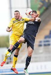 Queen of the South's Derek Lyle and Falkirk's Jonathan Flynn.<br /> half time : Falkirk 1 v 0 Queen of the South, Scottish Championship 5/10/2013.<br /> ©Michael Schofield.