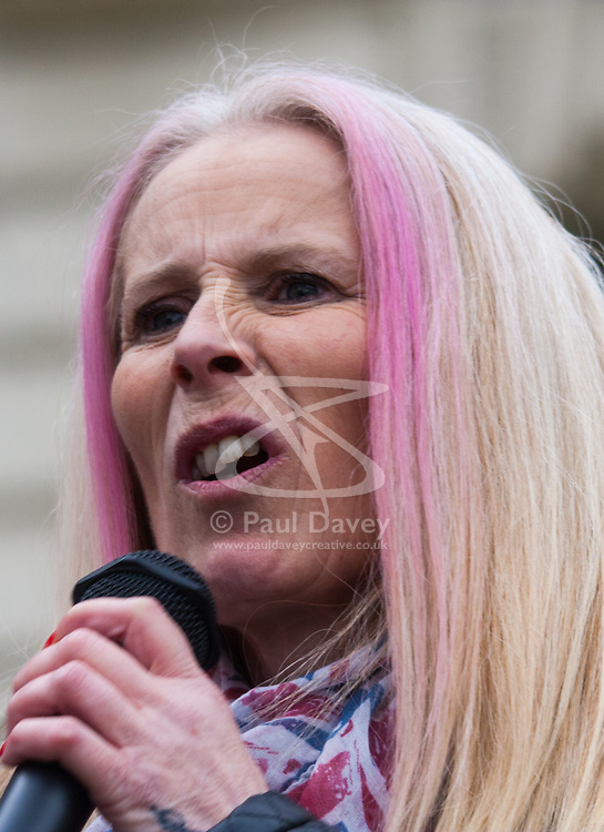 Whitehall, London, April 4th 2015. As PEGIDA UK holds a poorly attended rally on Whitehall, scores of police are called in to contain counter protesters from various London anti-fascist movements. PICTURED: A woman addresses the PEGIDA rally.