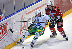 Tomaz Vnuk of Olimpija and Damjan Dervaric of Jesenice at ice hockey match Acroni Jesencie vs ZM Olimpija in second round of final of Slovenian National Championship,  on April 5, 2008 in Arena Podmezaklja, Jesenice, Slovenia. Acroni Jesenice won the game 6:1 and lead the series 2:0.  (Photo by Vid Ponikvar / Sportal Images)