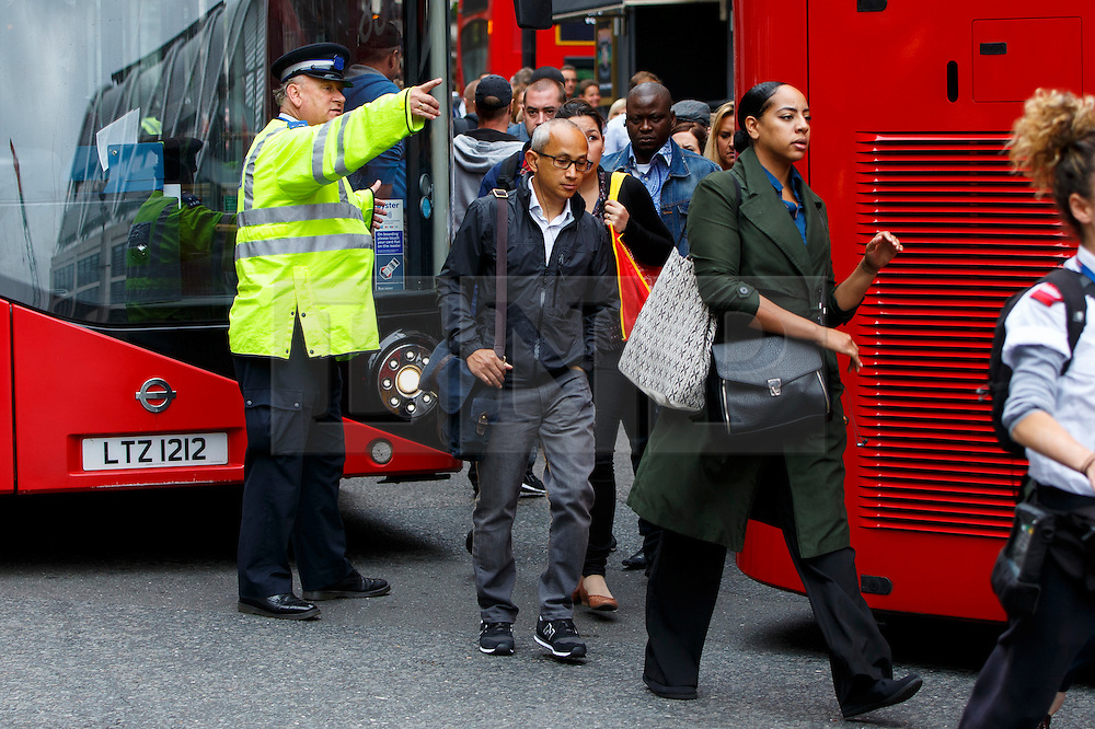 © Licensed to London News Pictures. 06/08/2015. London, UK. Commuters queuing for buses outside Victoria Station during the tube strike on Thursday, August 6, 2015. The strike is a 27-hour stoppage by about 20,000 Tube staff to shut down the entire London Underground network  over pay and conditions for new Night Tube. Photo credit: Tolga Akmen/LNP