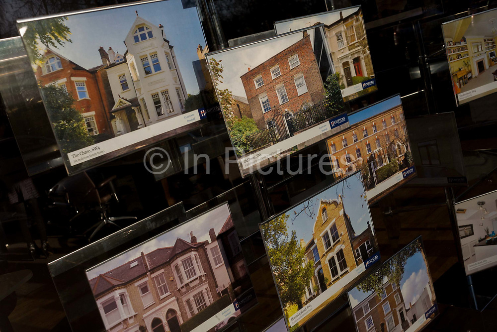 Photographs of properties are on view in the window of Hampton's International in Clapham High Street, south London. This is an affluent area of the capital, home to the well healed of the middle-classes and the values of these homes reflect their status in Clapham as a very expensive part in which to invest. Some are from the Edwardian era and others Victorian and even Georgian with freehold leases from £1.5 to £4 million at 2012 prices, in the middle of a recession.