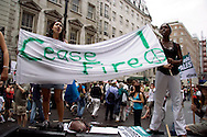 Girls holding up banner that says 'Cease Fire', at the Anti-war march, 22nd July, 2006, London, UK