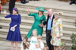 Sarah, Duchess of York with Nicola and George Brooksbank after the wedding of Princess Eugenie to Jack Brooksbank at St George's Chapel in Windsor Castle.