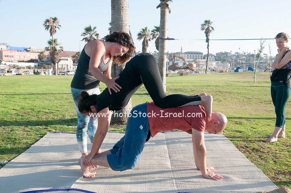 Acro Yoga practice session in Charles Clore Park on the Jaffa shore, Israel