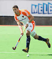 MELBOURNE -    Glenn Schuurman  tijdens de hockeywedstrijd tussen de mannen van Nederland en Belgie (5-4) bij de Champions Trophy hockey in Melbourne. links Valentin Verga. ANP KOEN SUYK