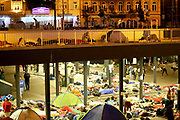 Refugees gather outside the Keleti train station in Budapest, Hungary, September 2, 2015. An estimated 3,000 people are now believed to be camped out at the station as authorities continue to block those without European visas or travel documents from boarding trains.