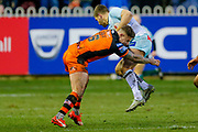 Castleford Tigers Joe Wardle (16) stops Widnes Vikings full back Rhys Hanbury (1)  during the Betfred Super League match between Castleford Tigers and Widnes Vikings at the Jungle, Castleford, United Kingdom on 11 February 2018. Picture by Simon Davies.