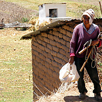 South America, Bolivia, Pariti. Local resident of Pariti Island on Lake Titicaca.