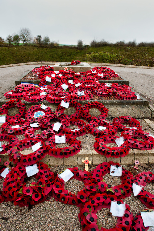 Poppy wreaths laid near the Lochnagar Crater. <br /> The Lochnagar Crater is the largest manmade crater created in WWI. The mine was laid by the 179th Tunneling Company Royal Engineers and it was exploded two minutes before 7:30 (the zero hour for the british offensive) on the morning of July 1st 1916.  At the time this was the largest man made explosion ever made and there are reports that it was heard in London. In 1978 the area was purchased by Richard Dunning who decided to reserve the place and make a memorial.