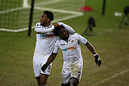 Wilfried Bony of Swansea city ® celebrates with Leroy Fer (l) after he  scores his teams 2nd goal. The Emirates FA Cup, 3rd round replay match, Swansea city v Wolverhampton Wanderers at the Liberty Stadium in Swansea, South Wales on Wednesday 17th January 2018.<br /> pic by  Andrew Orchard, Andrew Orchard sports photography.