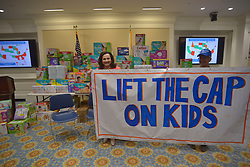 May 5, 2017 - Boston, Massachusetts, U.S - GEORGIA KATSOULOMITIS, Director of the Massachusetts Law Reform Institute on the left hold a banner opposing the Cap on Kids...The Cap on Kids-also called the ''family cap'' - denies welfare benefits to children conceived while-or soon after-the family began receiving benefits. As a result of the Cap on Kids, Massachusetts does not provide benefits for 9.400 children living in deep poverty. Their parents struggle to rovide even the most basic essential for their children including diapers to keep their babies dry, safe, and healthy...The Campaign to Lift the Cap on Kids has been collecting donated diapers for the event to illustrate this harsh policy's impact and are on display at the Statehouse during the meeting today. (Credit Image: © Kenneth Martin via ZUMA Wire)
