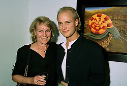 Artist the HON.JUSTIN PORTMAN and his mother VISCOUNTESS PORTMAN at an exhibition in London on 24th June 1997.LZR 7