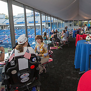 August 16, 2014, New Haven, CT:<br /> Guests attend the UTC Military outpost in the Pinpoint Pavilion during Military Night on day four of the 2014 Connecticut Open at the Yale University Tennis Center in New Haven, Connecticut Monday, August 18, 2014.<br /> (Photo by Billie Weiss/Connecticut Open)