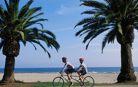 cyclists on tandem bicycle along bike path in Santa Barbara