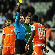 Referee's Huseyin Gocek show the yellow card to IBBSpor's Kamil Zayatte during their Turkish superleague soccer match Besiktas between IBBSpor at BJK Inonu Stadium in Istanbul Turkey on Sunday, 11 December 2011. Photo by TURKPIX