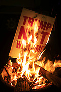 A poster with Donald Trump is set on fire on a Guy Fawkes bonfire on 5th of November 2020, in London, United Kingdom. 5th of November is traditional Guy Fawkes night in Britain and many have bonfires and fireworks remembering Guy Fawkes who almost managed to blow up the British parliament in 1605, - long before the US had a constitution. The poster is from when President Donald Trump visited the United Kingdom and it says 'Trump Not Welcome'.