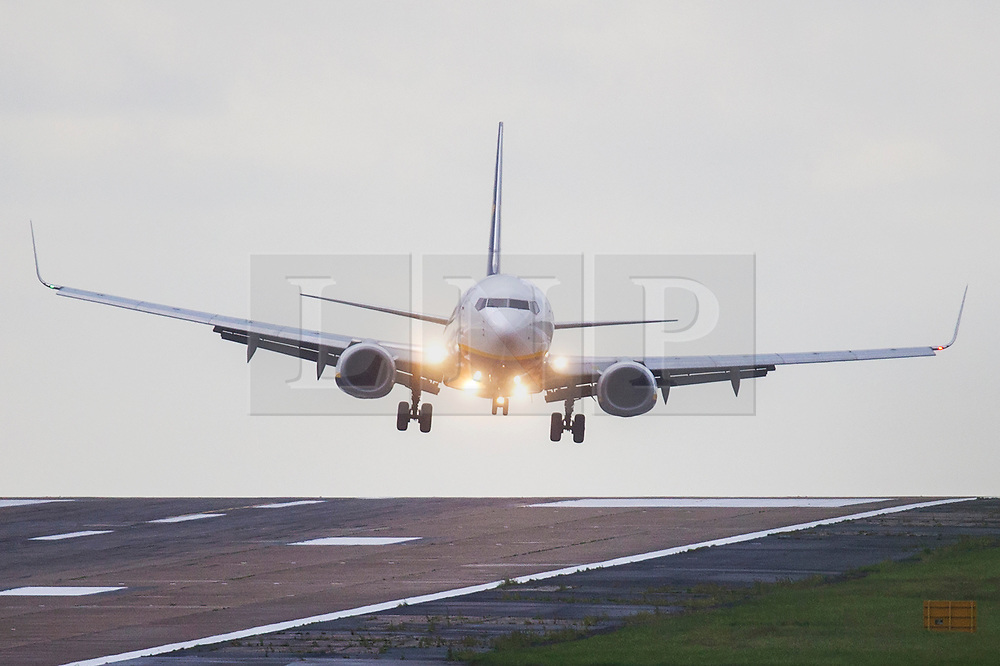 © Licensed to London News Pictures. 28/06/2020. Leeds UK. A Ryanair jet struggles to land in strong winds this morning at Leeds Bradford International airport as the Met Office issues a Yellow weather warning for Yorkshire. Photo credit: Andrew McCaren/LNP