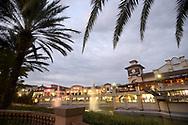 Palm trees frame the Dellagio Town Center shopping center in Orlando, Fla., Tuesday, Dec. 15, 2015. (Phelan M. Ebenhack via AP)