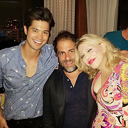 """Courtney Love releases a photo on Twitter with the following caption: """"""""Love you @BrettRatner @rossbutler #ratpac #brettratner #rossbutler #moviemaker #asianbradpitt #family  #13reasonswhy  #hollywood  🎂💕💕💕"""""""". Photo Credit: Twitter *** No USA Distribution *** For Editorial Use Only *** Not to be Published in Books or Photo Books ***  Please note: Fees charged by the agency are for the agency's services only, and do not, nor are they intended to, convey to the user any ownership of Copyright or License in the material. The agency does not claim any ownership including but not limited to Copyright or License in the attached material. By publishing this material you expressly agree to indemnify and to hold the agency and its directors, shareholders and employees harmless from any loss, claims, damages, demands, expenses (including legal fees), or any causes of action or allegation against the agency arising out of or connected in any way with publication of the material."""
