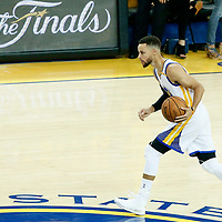01 June 2017: Golden State Warriors guard Stephen Curry (30) brings the ball up court during the Golden State Warriors 113-90 victory over the Cleveland Cavaliers, in game 1 of the 2017 NBA Finals, at the Oracle Arena, Oakland, California, USA.