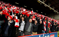 Bristol City fans with Red and White scarves gifted by Bristol Sport  - Photo mandatory by-line: Joe Meredith/JMP - Mobile: 07966 386802 - 25/01/2015 - SPORT - Football - Bristol - Ashton Gate - Bristol City v West Ham United - FA Cup Fourth Round