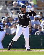 GLENDALE, ARIZONA - FEBRUARY 23:  Yonder Alonso #17 of the Chicago White Sox bats against the Los Angeles Dodgers on February 23, 2019 at Camelback Ranch in Glendale Arizona.  (Photo by Ron Vesely)  Subject:  Yonder Alonso