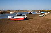 Boats in a tidal creek at Burnham Overy Staithe, north Norfolk coast, England