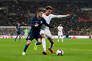 Dele Alli of England tackles Christian Politic of USA during the International Friendly match between England and USA at Wembley Stadium, London, England on 15 November 2018.