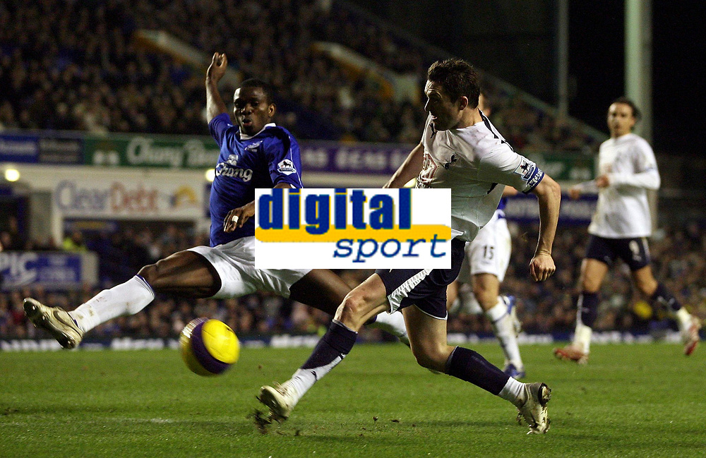 Photo: Paul Thomas.<br /> Everton v Tottenham Hotspur. The Barclays Premiership. 21/02/2007.<br /> <br /> Robbie Keane (R) of Tottenham shoots past Joseph Yobo.